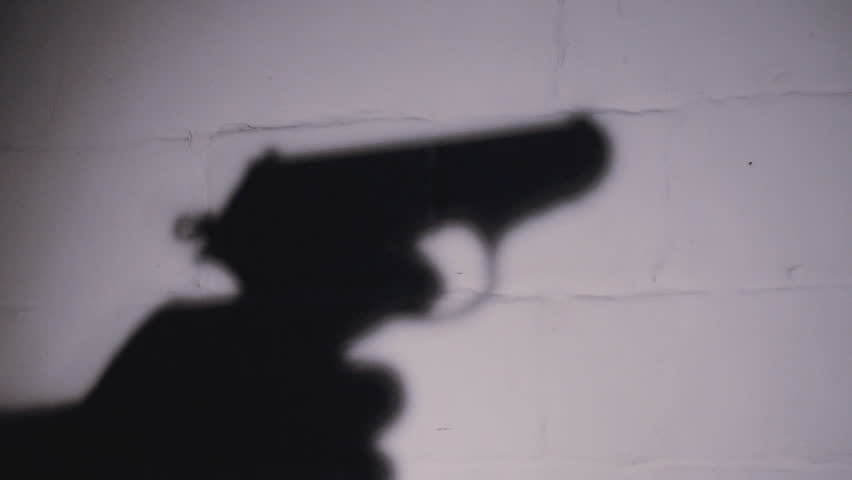 Gunman with automatic pistol used to illustrate the story [Photo credit: Shutterstock]