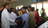 Delta State Governor, Senator Ifeanyi Okowa in handshake with one of the Student.