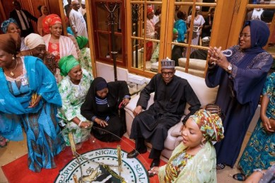 The wife of Buhari, Aisha, (Right of Buhari) surrounded by well-wishers thanking God for return of her husband .