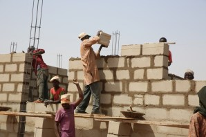 A cross section of the ongoing construction work of the 2-bedroom Semi –Detached Bungalows as part of the National Housing Programe of the Federal Government in Gombe State during the Hon.Minister 's inspection tour of the National Housing Programme site on Day Three of his inspection tour of Highway Projects in the North East Zone on Saturday 18th, March 2017.