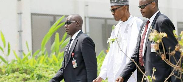 President Muhammadu Buhari with his security detail heading to his office