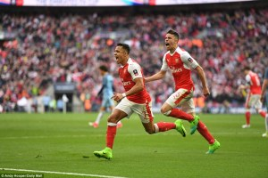 Sanchez races away to celebrate as his extra-time strike looks to have secured Arsenal's place in the FA Cup final [Photo Credit: Daily Mail]