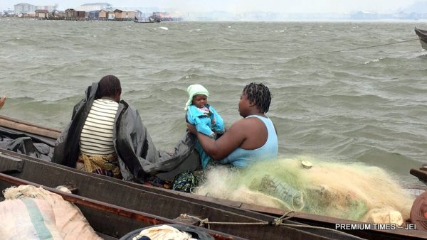 One of the residents of Otodogbame with her baby fleeing after the demolition