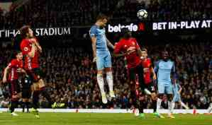 Nicolas Otamendi's header goes over the bar. Photograph: Jason Cairnduff/Reuters