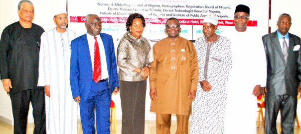 Minister of Health, Prof. Isaac Adewole (4TH R); Representative of the Permanent Secretary of the Ministry, Dr Wapada Balami (3RD L), and the Chairmen of Councils and Boards, of Federal Tertiary Health Institutions during their inauguration in Abuja on Friday (28/4/17). 02327/28/4/2017/Hogan-Bassey/ICE/NAN