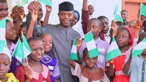 Acting President Yemi Osinbajo (M) with some selected FCT School Children during their visit to the Acting President at the Presidential Villa Abuja to commence the activities marking the 2017 Children Day Celebration in Abuja on Friday (26/5/17)