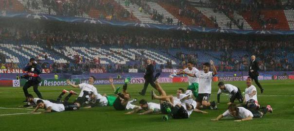 The Real Madrid players celebrate in front of their fans. Photograph: Sergio Perez/Reuters
