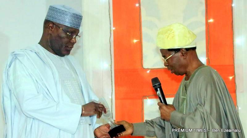 "Atiku Abubakar being conferred with an award as ""The Hero of Nigerian Democracy""."
