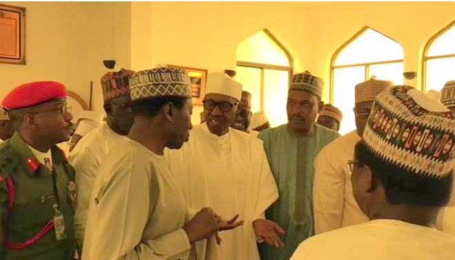 President Muhammadu Buhari discussing with NSA Babagana Munguno immediately after observing Juma'at Prayer at the Presidential Villa, Abuja. [Photo: Bashir Ahmaad]