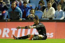 Cristiano Ronaldo celebrates after scoring the second goal [Photograph: Miguel Vidal/Reuters]
