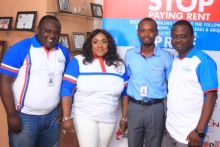 Foluke Daramola pictured in the middle flanked by officials of Sterling Homes