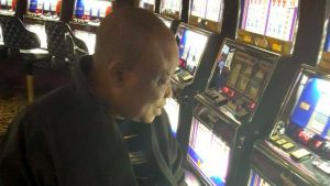 Folu Olamiti admiring gaming machines in Las Vegas