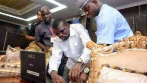 Yahaya Bello being registered by an INEC personnel in his office