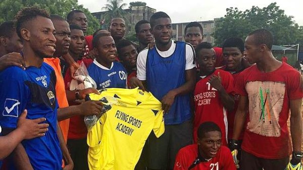 John Ogu presenting Jerseys to the team