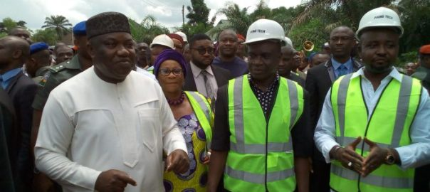 Gov. Ifeanyi Ugwuanyi of Enugu State (left) with the Secretary to the State Government, Dr. Gabriel Ajah (2nd right), the Chairman of Nkanu East Local Government Area, Hon. Ikechukwu Ubagu (right) and the Commissioner for Gender Affairs and Social Development, Hon. Mrs. Peace Nnaji at the inauguration of Amechi Idodo - Amauzam - Amagunze road in Nkanu East LGA, one of the 26 projects inaugurated simultaneously by the State government,  yesterday.