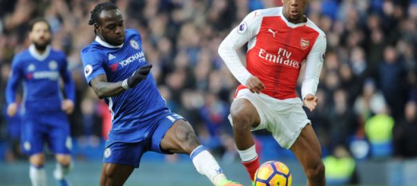 LONDON, ENGLAND - FEBRUARY 04:  Alex Iwobi of Arsenal takes on Victor Moses of Chelsea during the Premier League match between Chelsea and Arsenal at Stamford Bridge on February 4, 2017 in London, England.  (Photo by Stuart MacFarlane/Arsenal FC via Getty Images)