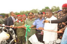 Gov. Ifeanyi Ugwuanyi of Enugu State cutting the tape to launch the state's Security/Neighbourhood Watch Endowment Fund at Michael Okpara Square Enugu, yesterday.  With him from the right are the Speaker, Enugu State House of Assembly, Rt. Hon. Edward Ubosi; the Commissioner of Police, Enugu State,  Mr. Dan Mallam Mohammed; the Garrison Commander, Nigeria Army 82 Division; the state's Commissioner for Human Capital Development, Hon. Obinna Mbeke