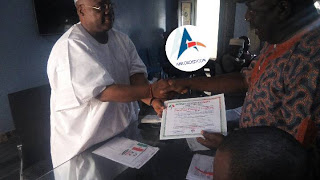 Ademola Adeleke collecting his PDP Clearance Certificate