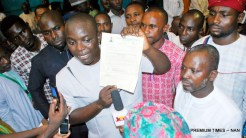 Factional President, National Association of Nigerian Students (NANS), Comrade Chinonso Obasi (M), displaying his Invitation Letter, after he was dragged out of the House of Representatives Chamber's, during the Second Anniversary of the 8th National Assembly in Abuja on Friday (9/6/17). 03125/9/6/2017/Hogan-Bassey/ICE/NAN