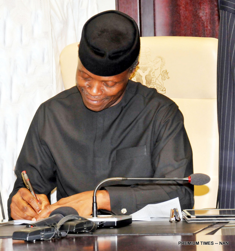 Acting President Yemi Osinbajo signing the 2017 Appropriation Act into law at the Presidential Villa in Abuja on Monday (12/6/17).03180/ 12/6/2017/Callistus Ewelike/BJO/NAN