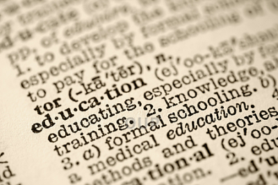 Selective focus of dictionary entry for the word education.