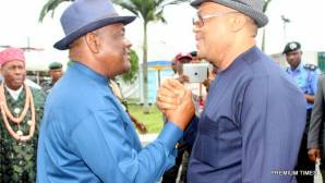 Rivers State Governor, Nyesom Ezenwo Wike (l) and Rivers State APC Chairman, Mr Davies Ikanya during an airport reception for the Acting President on Thursday in Port Harcourt