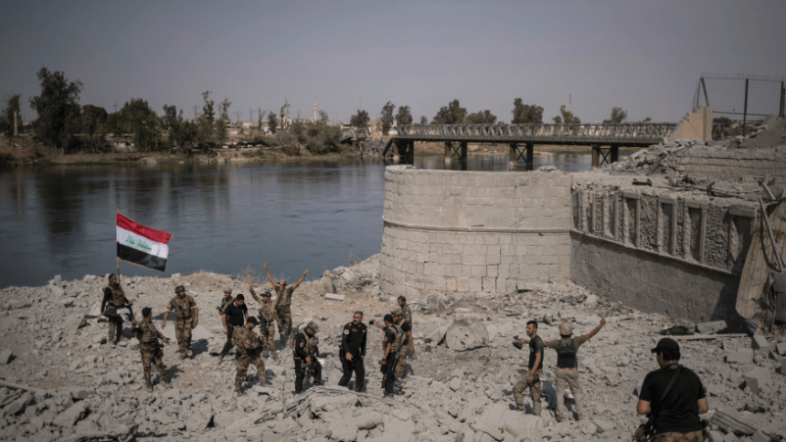 Iraqi forces celebrate victory in Mosul [Photo Credit: Fox News]