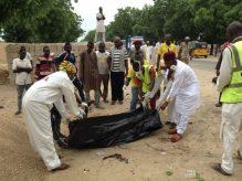 Borno State Management Agency (SEMA) officials evacuating body of a female suicide bomber at the Red Bricks quarters in Dalori, community in Maiduguri on Monday (24/7/17). 03738/24/7/2017/Suleiman Hamza/DKO/ICE/NAN