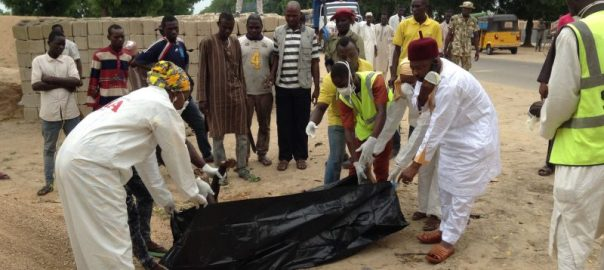 Borno State Management Agency (SEMA) officials evacuating body of a female suicide bomber at the Red Bricks quarters in Dalori, community in Maiduguri on Monday (24/7/17). 03738/24/7/2017/Suleiman Hamza/DKO/ICE/NAN