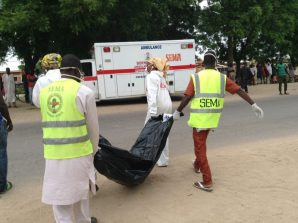 Borno State Management Agency (SEMA) officials evacuating body of a female suicide bomber at the Red Bricks quarters in Dalori, community in Maiduguri on Monday (24/7/17). 03739/24/7/2017/Suleiman Hamza/DKO/ICE/NAN