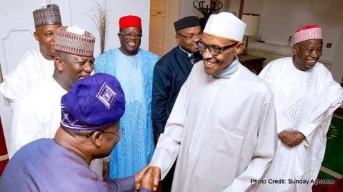 President Muhammadu Buhari exchanging pleasantries with Oyo State Governor, Abiola Ajimobi