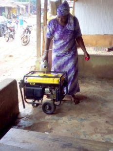 a tailor filling her generator with fuel for the day