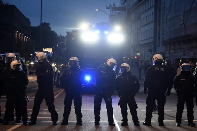 German riot police block a street during a protest at Schanzenviertel ahead the G20 summit in Hamburg, Germany, July 4, 2017. REUTERS/Fabian Bimmer