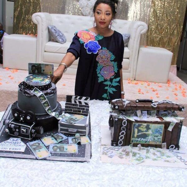 Lizzy Anjorin cutting the cake at her movie premiere