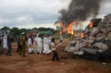 officials at the burning