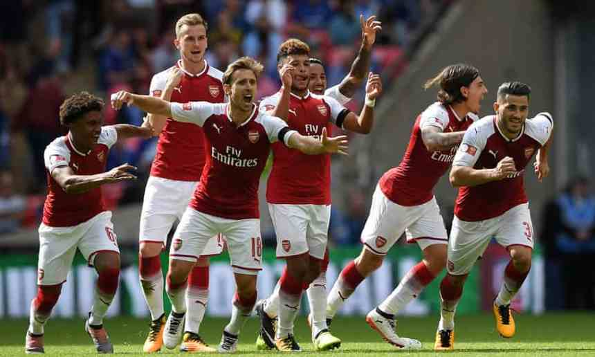 Arsenal players celebrate winning the penalty shoot-out. Photograph: Hannah Mckay/Reuters