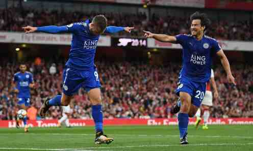 Jamie Vardy celebrates with Shinji Okazaki after scoring the second. Photograph: Shaun Botterill/Getty Images