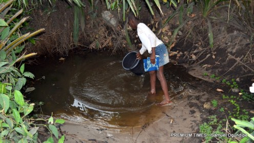 A child fetching water from a contaminated pond