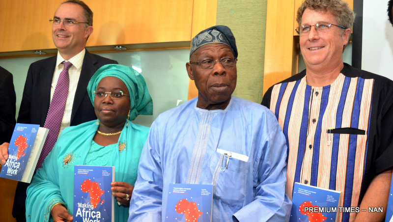 """FROM LEFT: A retired Maj.-Gen. in the British Army, Dickie Davis; Deputy Governor of Lagos State, Mrs Idiat Adebile; Formal President Olusegun Obasanjo; and Director of Brenthurst Foundation, MR Greg Mills, at the launch of a book titled: """"Making Africa Work"""", in Lagos on Wednesday (2/8/17). 03984/2/8/2017/Dapo Kayode/BJO/NAN"""