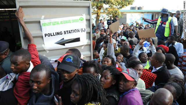 Kenyans on a queue voting. [Photo Credit: CNN.com]
