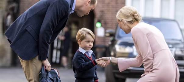 Britain's Prince George (C) accompanied by Britain's Prince William (L), Duke of Cambridge arrives for his first day of school at Thomas's school in Battersea where he is met by Helen Haslem (R) head of the lower school. / AFP PHOTO / POOL / RICHARD POHLE. [Photo credit: Free Press Journal]