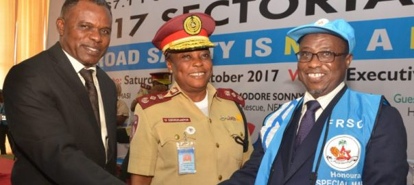 NNPC GMD, Dr. Maikanti Baru (right) in a warm handshake with National Emergency Management Agency(NEMA) Director of Search and Rescue, Air Commodore Sonny Paul Ohemu, after the GMD was decorated as Honourary Special Marshal at a ceremony in Abuja. With them is Federal Road Safety Corps (FRSC) Deputy Corps Marshal, Operations, Ojeme Ewhrudjakpor.