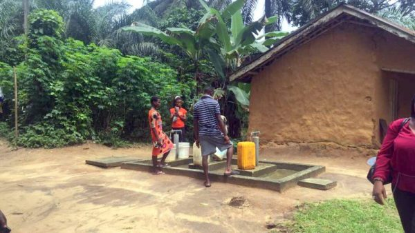 Children of Ikot Nkpenne community, in Nsit Atai Local Government Area of Akwa Ibom State, fetching water from the borehole constructed by UNICEF and EU [Nike Adebowale]