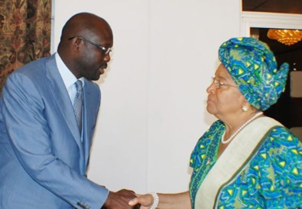 George Weah shakes hands with President Ellen Johnson Sirleaf [Photo: FrontPageAfrica]