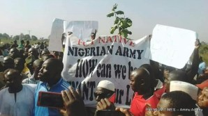 Protesters block Abuja highway, accuse govt of excessive ceding of land to Army (Photo by Aminu Adamu, 11/28/2017)