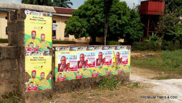 Furthermore, campaign posters of both APGA and APC candidates are visible at the entrance of the premise.
