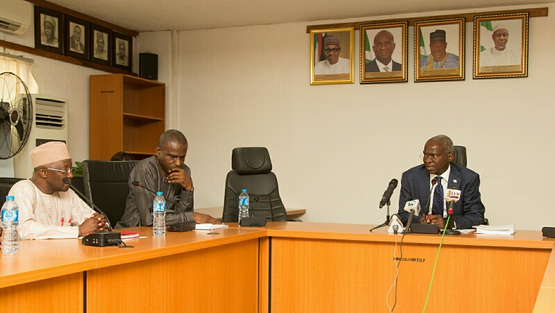 Hon. Minister of Power, Works & Housing, Mr Babatunde Fashola, SAN(right), Permanent Secretary, Power, Engr. Louis Edozien(middle) and Vice Chairman, Nigerian Electricity Regulatory Commission, Mr Sanusi Garba(2nd left) during the presentation of the Eligible Customers Regulations 2017 to the Hon. Minister at the Ministry of Power, Works & Housing Headquarters, Mabushi, Abuja on Monday 6th, November 2017.