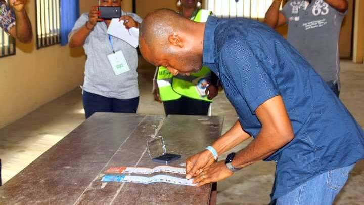 Akwa Ibom Speaker, Onofiok Luke, casting his vote during local govt elections in the state