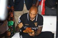 Arsenal legend, Thierry Henry, eating Nigerian jollof rice.