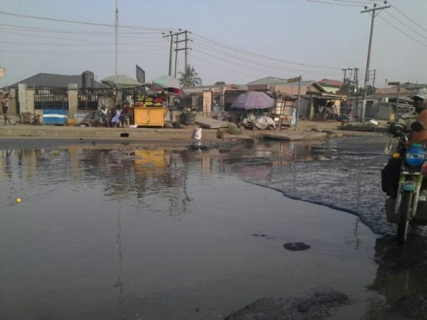 Dilapidated road, manholes in front of Lagos council secretariat causes traffic